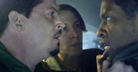 A scene from '5th Passenger', featuring characters played by Manu Intiraymi, Morgan Lariah, Tim Russ