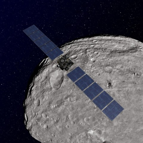 An artist's rendition of the Dawn probe over Vesta. Dawn visited Vesta between 2011 and 2012.