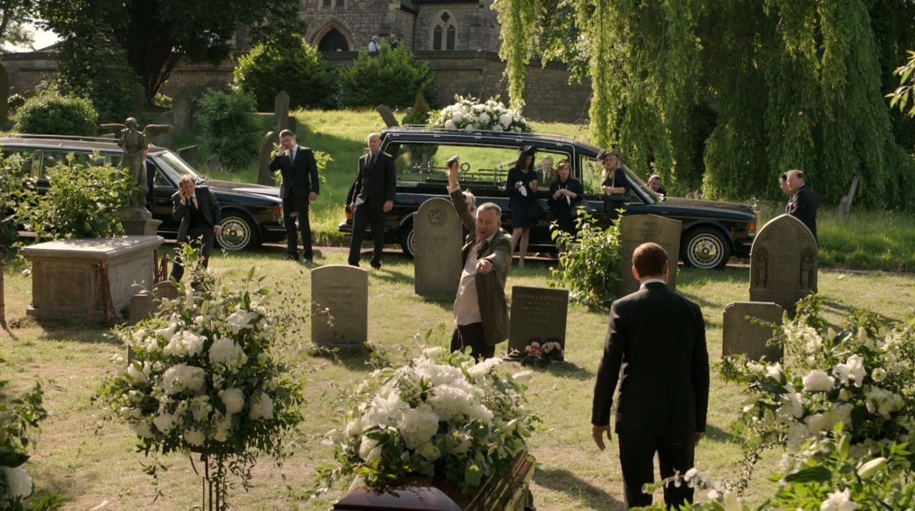 Elementary - Lestrade (Bill Pertwee) with a hand grenade at a funeral