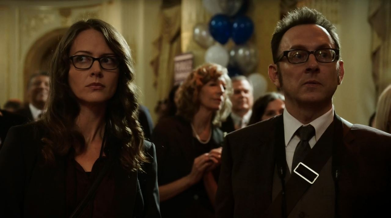 Root (Amy Acker) and Finch (Michael Emerson) observing election results