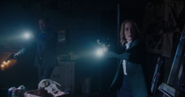 X-Files Revival miniseries. Mulder and Scully search a darkened room