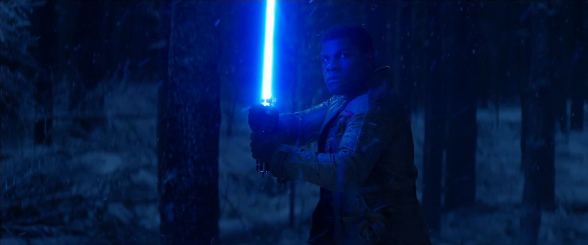 Finn wields a lightsaber. The Force Awakens trailer released