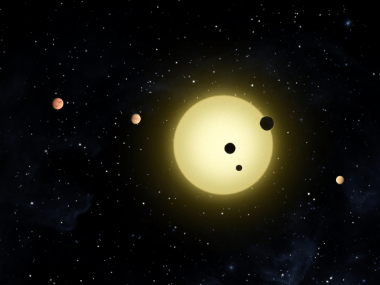 Kepler-11 is a sun-like star around which six planets orbit. At times, two or more planets pass in front of the star at once, as shown in this artist's conception of a simultaneous transit of three planets observed by NASA's Kepler spacecraft on Aug. 26, 2010. Image credit: NASA/Tim Pyle