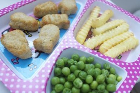 child's lunch - peas, french fries, nuggets, plated