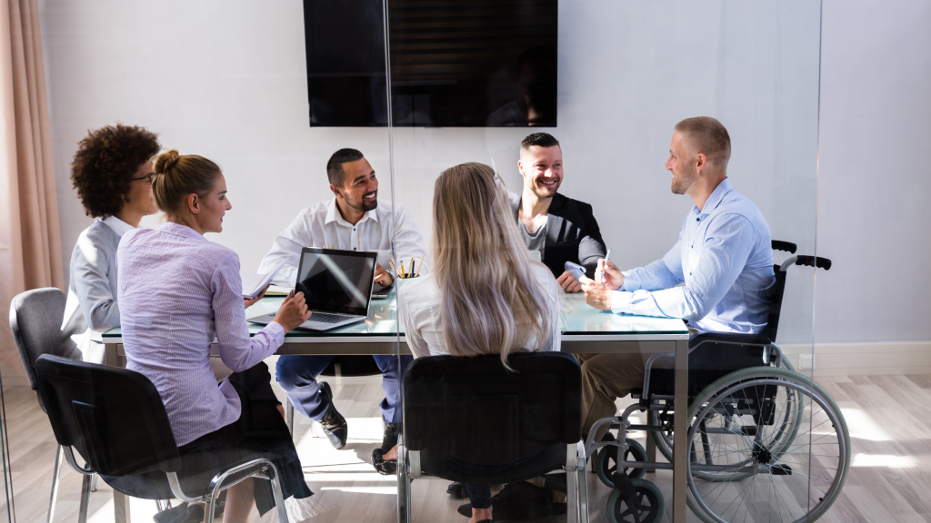 Diverse group of six business people meeting around a table.