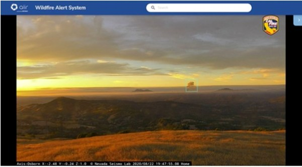 Forest fire smoke detected (in the blue box) in Osborne, California by Alchera's AI, taken during the bidding period in August 2020.