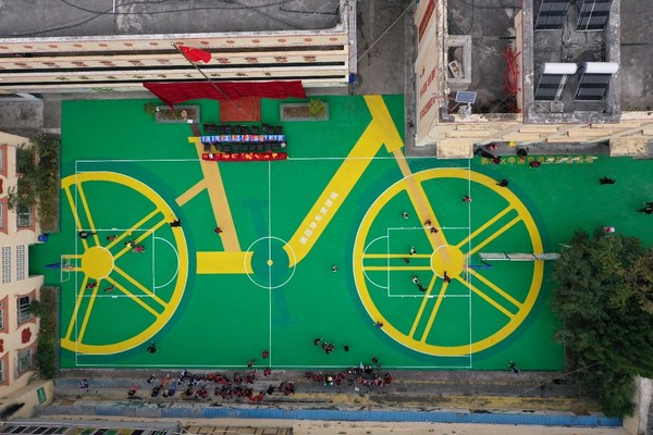 A sports ground donated to a rural primary school in Sichuan province, created with recycled materials from 3,500 Meituan Bikes tires