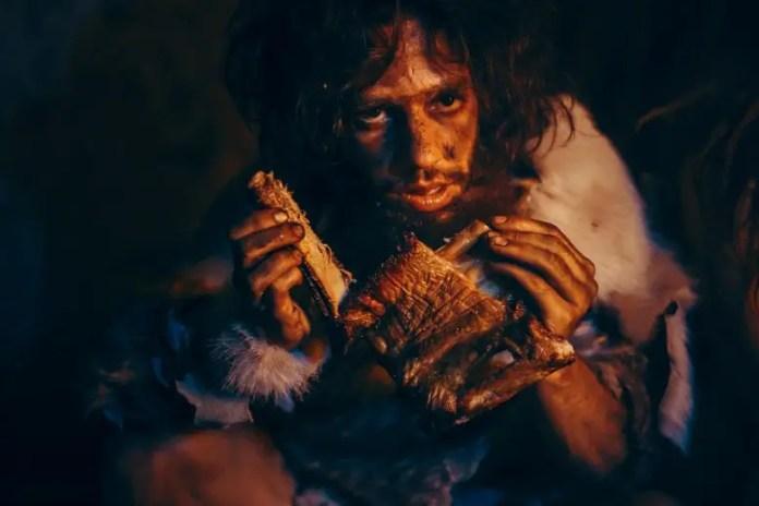 Caveman Eating Meat