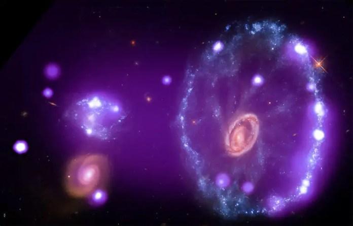 Chandra Cartwheel Galaxy: NASA: Stunning footage of galaxies, stars, supernova remnants