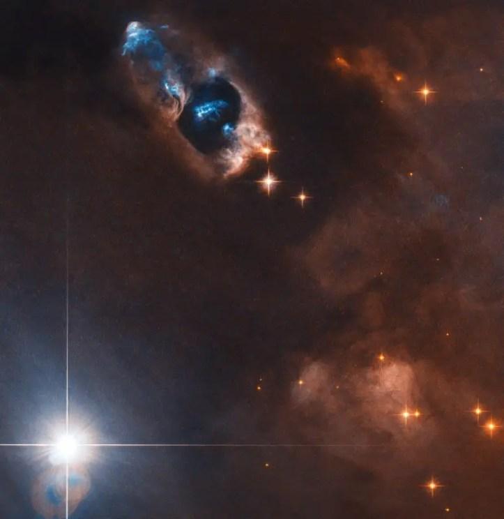 Hubble Views Smoking Gun of a Newborn Star