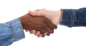Handshake between two women of different races