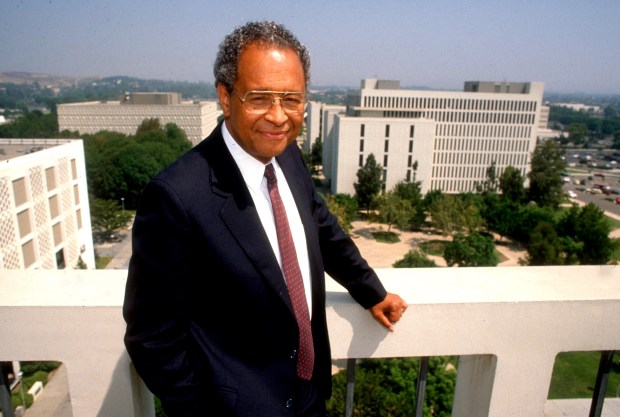 Milton Gordon on a balcony overlooking the campus. (File Photo, Orange County Register/SCNG)