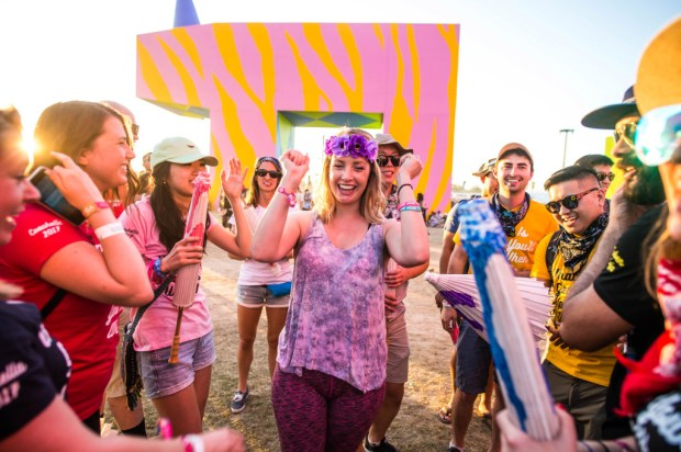 """Christina Brown, 28, center, along with with friends celebrate after being proposed by boyfriend Luke Pappis, 28, not pictured, at the center of """"Is this what brings things into focus?"""" art installation during Coachella Valley Music and Arts Festival in Indio on Friday, April 21, 2017. The two UCLA graduates have been dating for 9 years prior to her saying yes. (Photo by Watchara Phomicinda, The Press-Enterprise/SCNG)"""