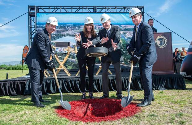 Susan and Henry Samueli, center, owners of the Anaheim Ducks, drop a giant hockey puck as Michael Schulman, left, CEO of the Anaheim Ducks and Irvine Mayor Donald P. Wagner, right, kickoff the groundbreaking of Great Park Ice Sports Complex at the Orange County Great Park in Irvine on Thursday morning, February 16, 2017. It will be one of the largest public ice facilities in the country and will open in mid 2018. (Photo by Mark Rightmire, Orange County Register/SCNG)