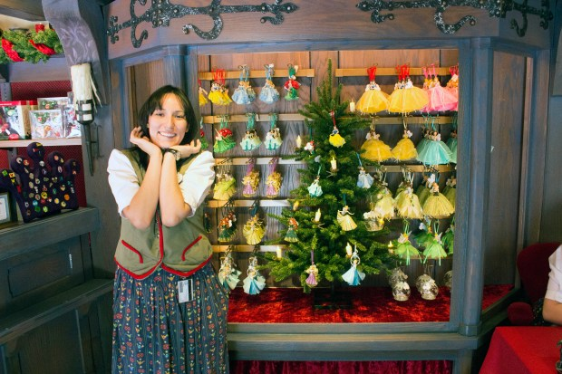 Briana, the hostess in the Castle Holiday Shoppe, gave the photographer a pleasant smile inside the new shop, which is located where the Castle Heraldry Shoppe once stood until it permanently closed in December 2016. Disneyland Resort officials said the new shop is a permanent addition. (Photo by Mark Eades, Orange County Register/SCNG)
