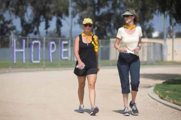 From left, Amy Triscari and Susan Smith participate in a Relay for Life event hosted by Laguna Niguel and Aliso Viejo at Niguel Hills Middle School in 2015.Cancer Society.