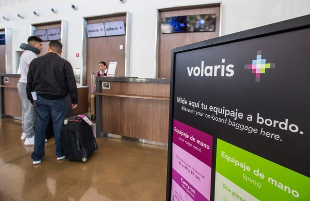 Travelers check in for a Volaris Airlines flight in the Cross Border Xpress building in San Diego on Thursday, April 20, 2017. The facility allows for a traveler to park in the U.S., check in for a flight, and then walk across an indoor elevated walkway to a flight out of the Tijuana International Airport without ever actually setting foot in the city of Tijuana. (Photo by Mark Rightmire,Orange County Register/SCNG)