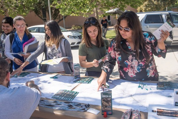 Attendees of the Sustainable Transportation Expo's Bike Fest look over a map of Metrolink's train lines throughout Southern California at Cal State Fullerton on Thursday.(Photo by Nick Agro, Orange County Register/SCNG)
