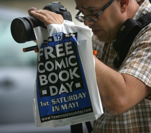 Kirk Kushin, 45, gathers video of costumed comic fans during Free Comic Book Day at 4 Color Fantasies in Rancho Cucamonga, on Saturday, April 7, 2016.