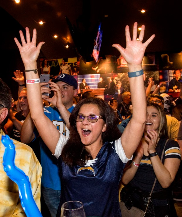 As the Chargers announce their first round draft pick, Gloria Padilla of Chula Vista cheers at the ESPN Zone in Anaheim on Thursday, April 27, 2017. The Chargers chose wide receiver Mike Williams as the 7th overall pick of the 2017 NFL draft. (Photo by Paul Rodriguez, Orange County Register/SCNG)