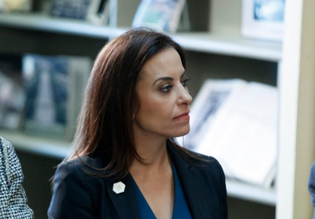 """FILE - In this April 11, 2017 file photo, Dina Powell, President Donald Trump's senior counselor for economic initiatives, listen during a meeting between President Donald Trump and business leaders in the State Department Library of the Eisenhower Executive Office Building on the White House complex in Washington. In a White House split between outsider ideologues and more traditional operators, Powell is viewed as a steady force in the growing influence of the latter. A newer addition to the team, her West Wing experience, conservative background and policy chops have won over Trump's daughter and son-in-law. Now, as the president turns his attention to international affairs, attempting to craft a foreign policy out of a self-described """"flexible"""" approach to the world, Powell is at the table. (AP Photo/Evan Vucci, File) ORG XMIT: WX103"""