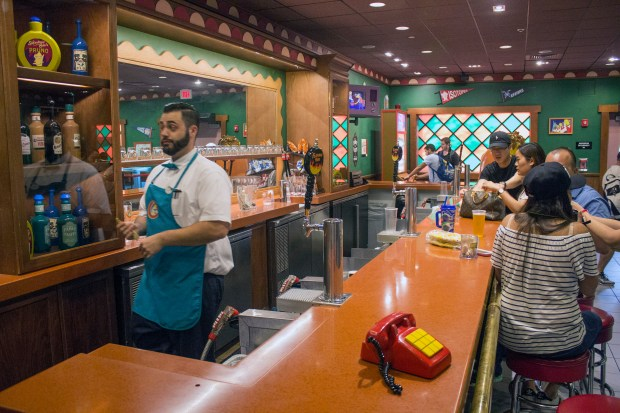 If the phone rings, it will probably be one of the Simpsons' kids on the other end asking you to page someone with a funny name in Moe's Tavern in Springfield at Universal Studios Florida. (Photo by Mark Eades, Orange County Register/SCNG)