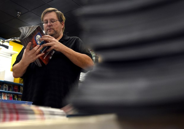 Volunteer Bernard Tyler helps count comic books, for Free Comic Book Day, at 4 Color Fantasies in Rancho Cucamonga, CA.,Tuesday, May 2, 2017. (Staff photo by Jennifer Cappuccio Maher/Inland Valley Daily Bulletin/SCNG)