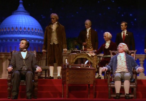 Presidents Abraham Lincoln (left front) and George Washington are two of the presidents of the United States of America on stage at once in the Hall of Presidents attraction in Liberty Square at Walt Disney World's Magic Kingdom. (Photo by Courtesy, Walt Disney World Resort)