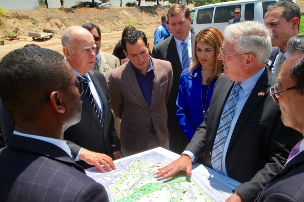 Gov. Jerry Brown takes a tour of two proposed sites for a state-run military veterans cemetery in Irvine on May 12, 2017. (Courtesy of California State Assembly)