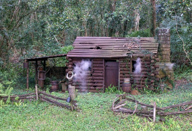 Smoke wafts out the windows and the chimney from this settler's cabin in the back country area of Frontierland in the Magic Kingdom of Walt Disney World. (Photo by Mark Eades, Orange County Register/SCNG)
