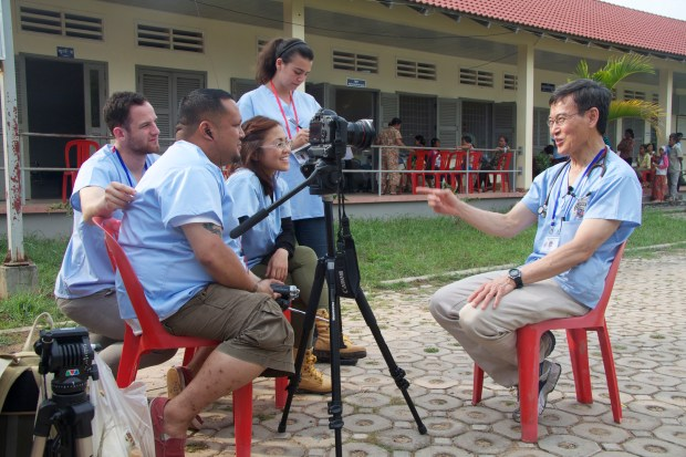 Cal State Fullerton students interview a doctor in rural Cambodia while on a trip organized by professor Jeff Brody. (Photo courtesy of Jeff Brody, Cal State Fullerton)