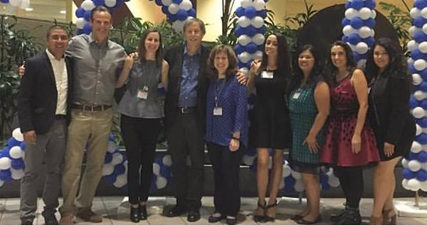 Some of his former students flank Cal State Fullerton professor Jeff Brody at an April 25, 2017, Communications Week panel on campus. (Photo courtesy of Darleene Powells)