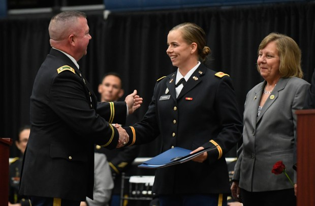 2nd Lt. Katherine Harris of Fullerton, center, is congratulated by Lt. Col. Mark Waters, left. (Michael Kitada Contributing Photographer)