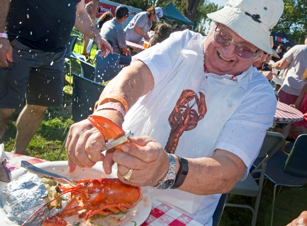 Water sprays as Henry Schneider of North Tustin cracks open his lobster at the ninth annual Lobsterfest. The all you can eat lobster festival is one of Tustin's big events, put on by the Rotary Club. (Photo by Michael Goulding, Contributing Photographer)