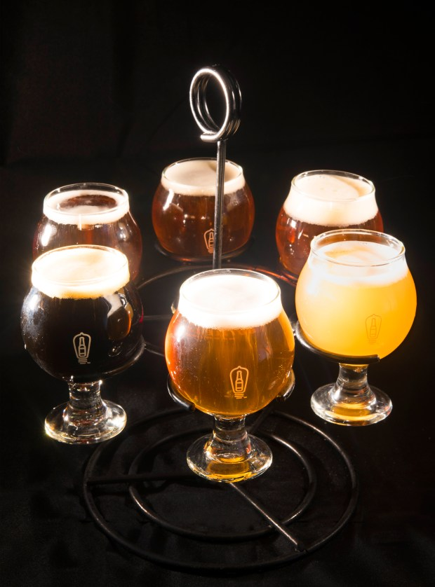 Anaheim's Bottle Logic craft brews tastings include, clockwise from center front, (714) Blonde, a clean, crisp Orange County Blonde Ale that's refreshing, Recursion, a West Coast style IPA, Double Actuator, a tropical, malt driven double IPA, Lagerithm, an American dark lager that and American Beer Festival Gold Medal winner for 2015 and 2016, Circadian Rhythm, a black IPA with roasty coffee notes and Hostile Intent, a tart wheat ale finished with kiwi and starfruit. (Photo by Cindy Yamanaka, Orange County Register/SCNG)