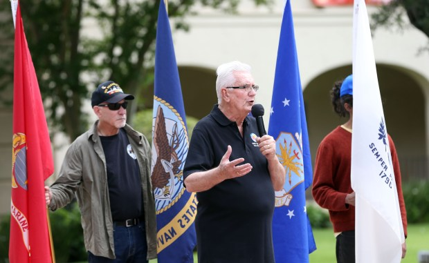 Corona Mayor Dick Haley, center, addresses the crowd during the Corona Chamber of Commerce's 3rd annual Memorial Mile March on the lawn of the Corona Historic Civic Center in Corona, CA Saturday, May 27, 2017. (Photo by Mark Dustin, Contributing Photographer)