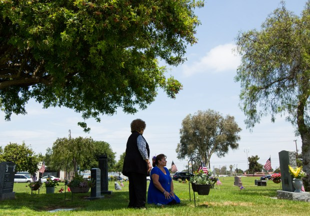 Sara Drosco of Santa Ana, left, and her daughter Louisa Drosco of Fountain Valley visit the grave of her husband Ernest Louis Drosco, a Korean War veteran, after the 63rd Annual Memorial Day Services at Harbor Lawn-Mount Olive Memorial Park on Monday, May 29, 2017 in Costa Mesa, Calif. Ernest passed away in April and it was Sara and Louisa's first time attending the Memorial Day service. (Photo by Josh Barber, Contributing Photographer)