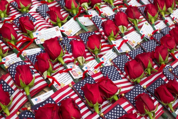 Roses placed on the Fountain Valley Veterans Memorial in honor of fallen soldiers during a Memorial Day Ceremony on Monday, May 29, 2017. (Photo by Drew A. Kelley, Contributing Photographer)