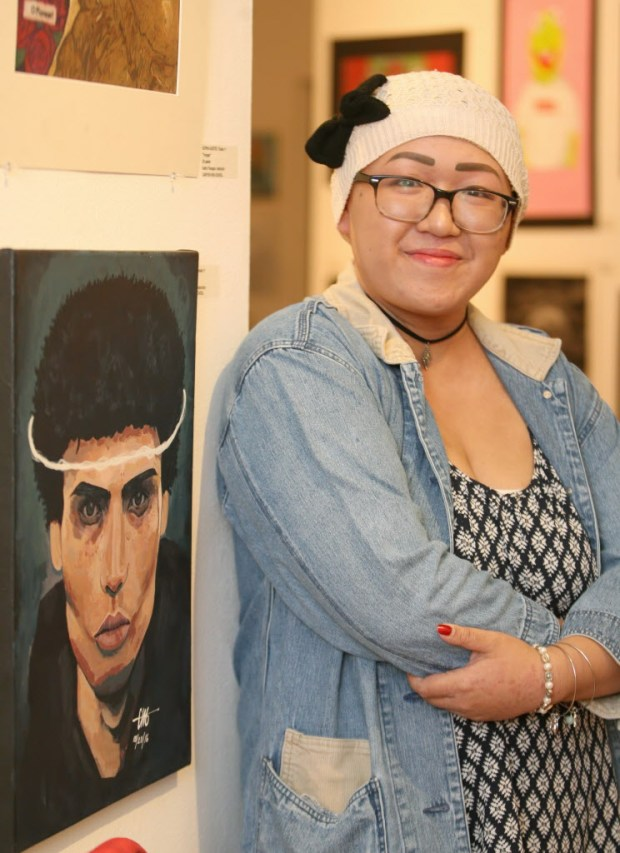 "Ciarra Giron, 11th grader from Canyon High School, poses next to her art ""Purgatory"" during the Artist Village Art Walk at the Santa Ana College Santora Arts Building on Saturday night, June 03, 2017. High school students are invited by Santa Ana College to show their work in a formal art gallery setting throughout the month of June. (Photo by Ana P. Gutierrez-Garcia, Contributing Photographer)"