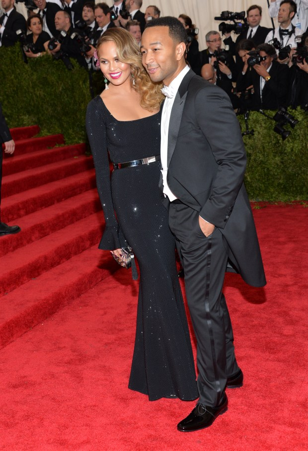 Chrissy Teigen, left, and John Legend arrive at The Metropolitan Museum of Art's Costume Institute benefit gala May 4, 2015, in New York. Teigen was wearing a custom dress created by St. John Knits in Irvine. (Photo by Evan Agostini/Invision/AP)