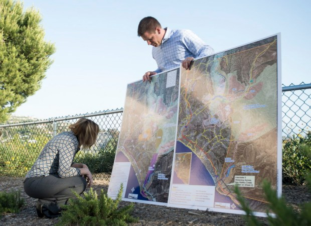 Co-founders of Coalition to Save San Clemente's Wendy Shrove and Dan Bane look at a map of options to increase mobility to in south Orange County. (Photo by Kyusung Gong/Orange County Register/SCNG)