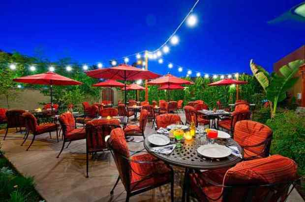 El Mirasol's outdoor patio at the Los Arboles hotel is a beautiful setting for lunch or dinner in Palm Springs. (Photo courtesy El Mirasol)