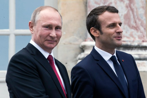 French President Emmanuel Macron, right, and his Russian counterpart Vladimir Putin visit an exhibition about Russian emperor Peter the Great at the Grand Trianon after a working meeting at the Versailles Palace near Paris, France, Monday, May 29, 2017. (Etienne Laurent/Pool Photo via AP) ORG XMIT: REB150