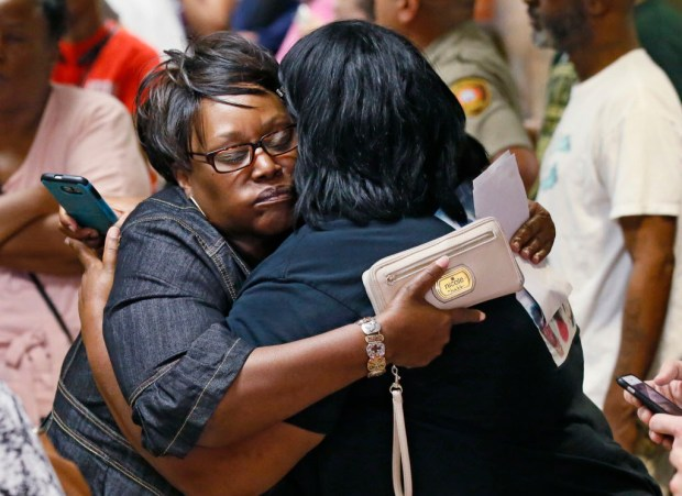 Two women embrace after leaving the courtroom and hearing the verdict in the trial of Tulsa police officer Betty Jo Shelby in Tulsa, Okla., Wednesday, May 17, 2017. Shelby was charged with first-degree manslaughter in the fatal shooting of Terence Crutcher, an unarmed black man. Shelby was found not guilty. (AP Photo/Sue Ogrocki) ORG XMIT: OKSO103