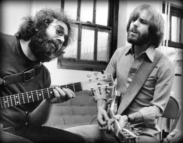 Jerry Garcia and Bob Weir backstage in 1977. (Photo courtesy of Peter Simon)