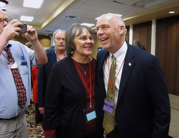 FILE - In this March 6, 2017, file photo, Greg Gianforte, right, receives congratulations from a supporter in Helena, Mont. Montana voters are heading to the polls Thursday, May 25, 2017, to decide a nationally watched congressional election amid uncertainty in Washington over President Donald Trump's agenda and his handling of the country's affairs. (AP Photo/Matt Volz, File) ORG XMIT: PDX309
