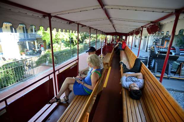 People relax on the shade covered Disneyland Railroad at Disneyland in Anaheim, California, on Wednesday, March 15, 2017.(Photo by Jeff Gritchen, Orange County Register/SCNG)