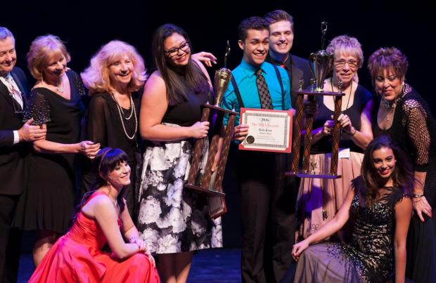 Amanda Dayhoff, of Orange Lutheran High School, with trophy, and Adrian Villegas, with certificate, of Huntington Beach Academy for the Performing Arts, pose with presenters at the MACY Awards in 2015. (File photo by Ana Venegas, Orange County Register/SCNG)