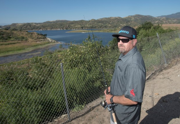 This is as close as Scott Noseworthy 50, Villa Park, can get to fishing at Irvine Lake now. Noseworthy fished the lake three to four times a week for 27 years, and is unhappy about the delay to reopen the lake. in Silverado Canyon, CA on Monday, May 1, 2017. (Photo by Sam Gangwer, Orange County Register/SCNG)