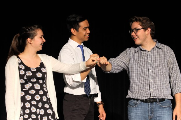 """Gwyneth Lutovsky, Zane Camacho and Josiah Cajudo perform a scene from """"Merrily We Roll Along."""" Lutovsky and Camacho have said that over the years they have graduated to more dramatic roles. Courtesy of Amara Watson."""